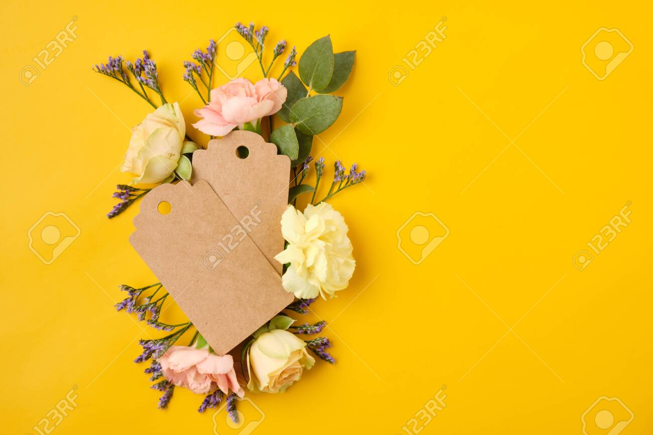 blank gift tag label with flowers on yellow background invitation stock photo picture and royalty free image image 141854558