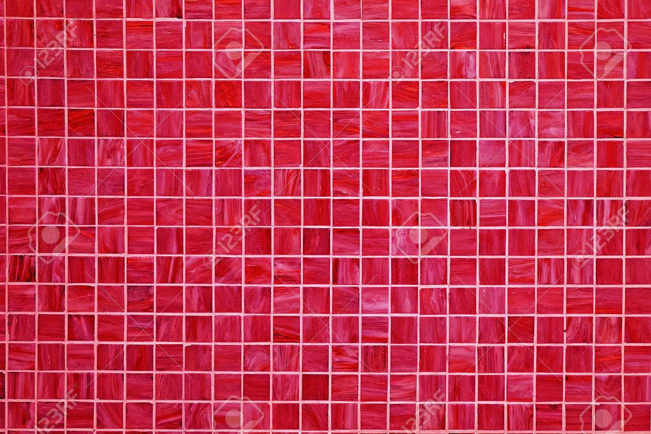 a red square tiled background with small mosaic tiles