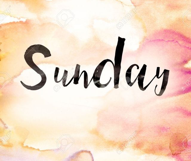 Stock Photo The Word Sunday Written In Black Paint On A Colorful Watercolor Washed Background