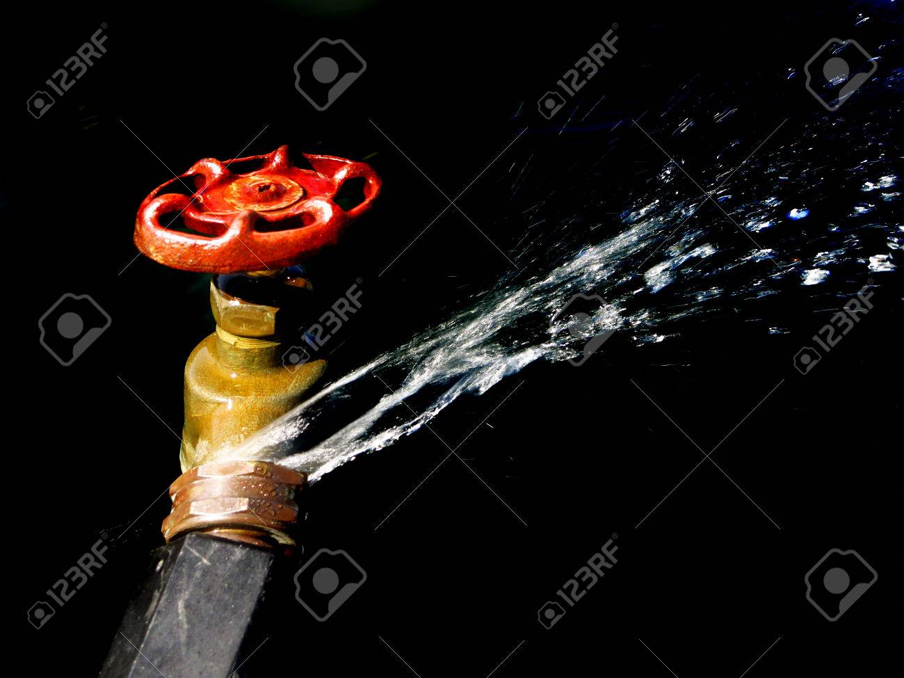 detail of hose faucet connection leaking and squirting water stock photo picture and royalty free image image 30187671