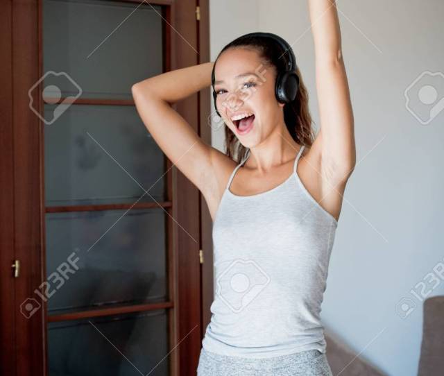 Stock Photo Young Asian Teen Woman Portrait Looking At Camera Smiling And Dancing With Headphones Healthy Lifestyle