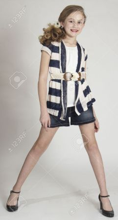 Young Teen Girl Modeling Fashion Clothing In Studio Stock Photo     Stock Photo   Young Teen Girl Modeling Fashion Clothing in Studio