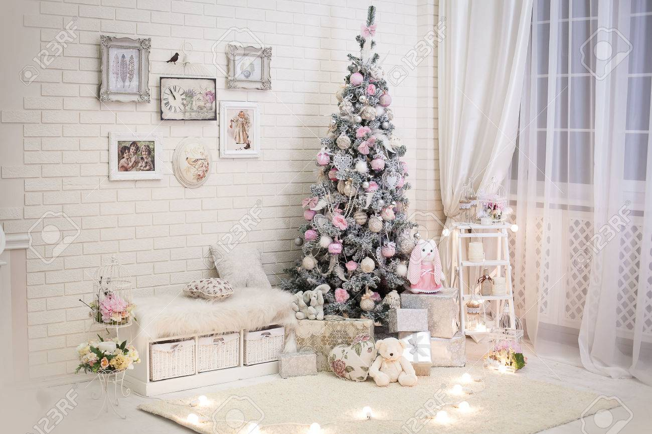 christmas room in shabby chic style decorated new year tree with gift boxes under it