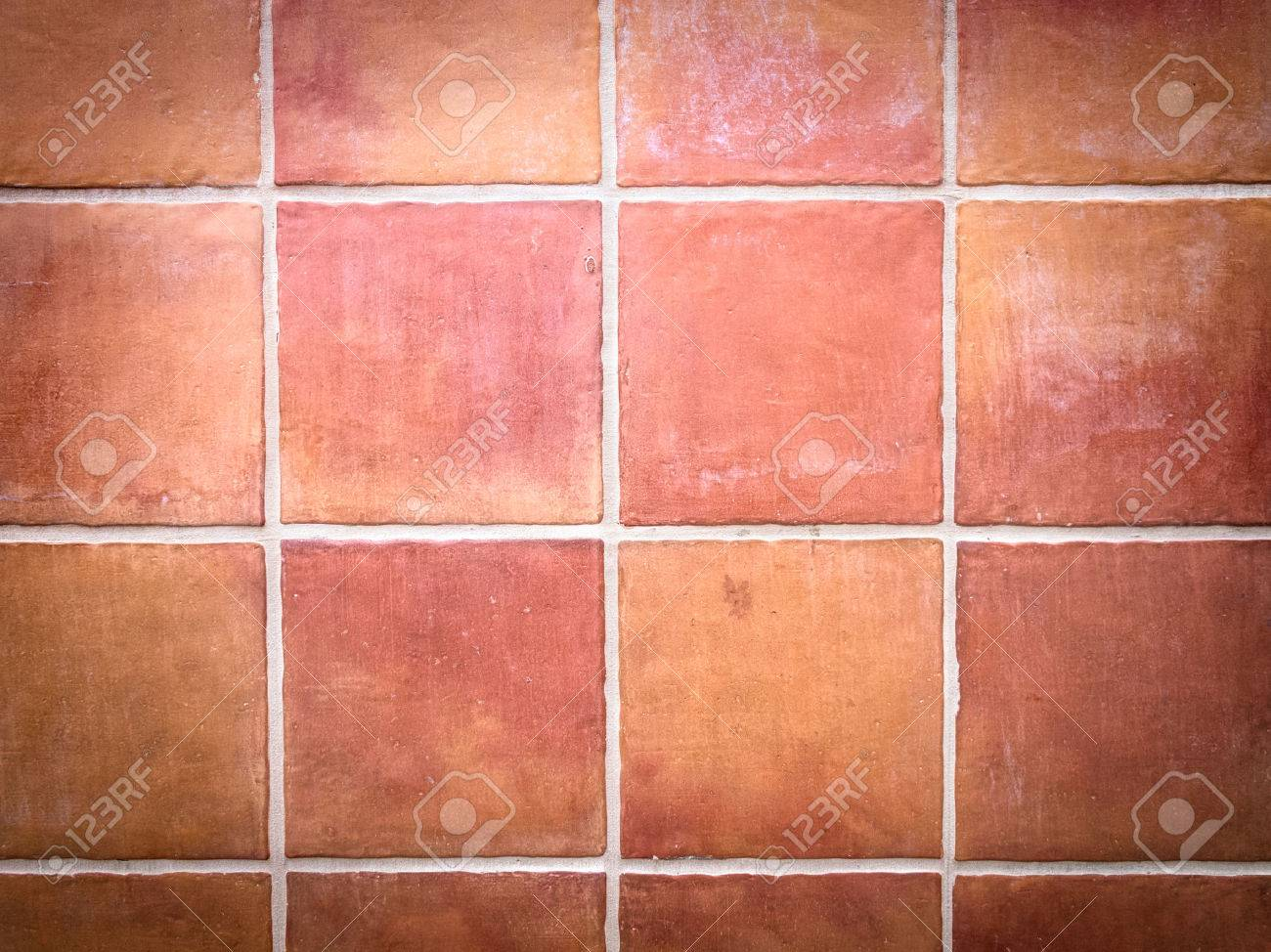 red stone wall tile with white grout