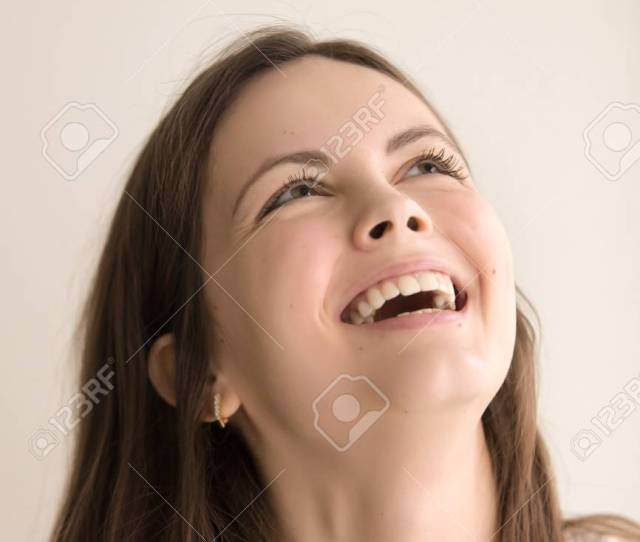 Headshot Portrait Of Laughing Young Model Cute Teen Girl With Happy Facial Expression Looking Up