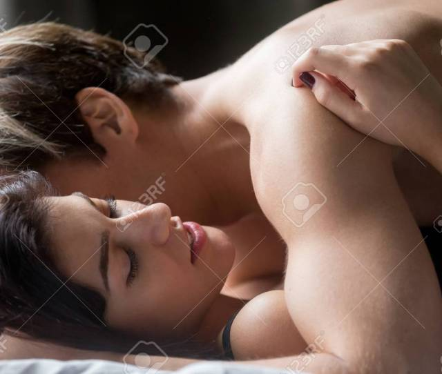 Sensual Couple Having Sex Making Love Aroused Beautiful Hot Woman Embracing Lover Lying On Bed