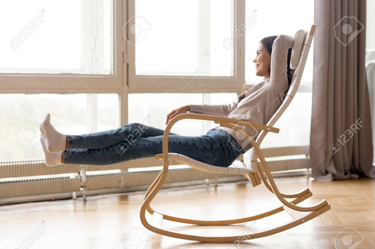 Smiling Woman Relaxing In Comfortable Rocking Chair At Home Stock Photo Picture And Royalty Free Image Image 118053946