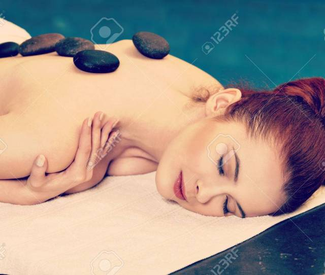 Stock Photo Stone Massage Sensual Woman Getting A Hot Stone Massage At Spa Salon Instagram Style
