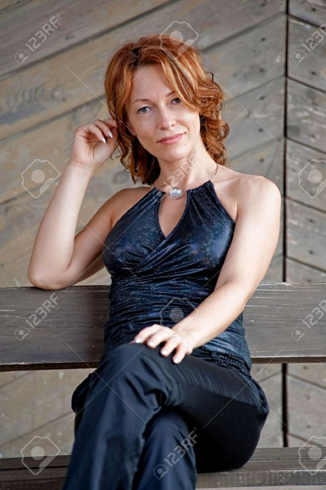 Beauty Mature Woman Sitting Lean On Old Wooden Board Wall Stock Photo 8265918