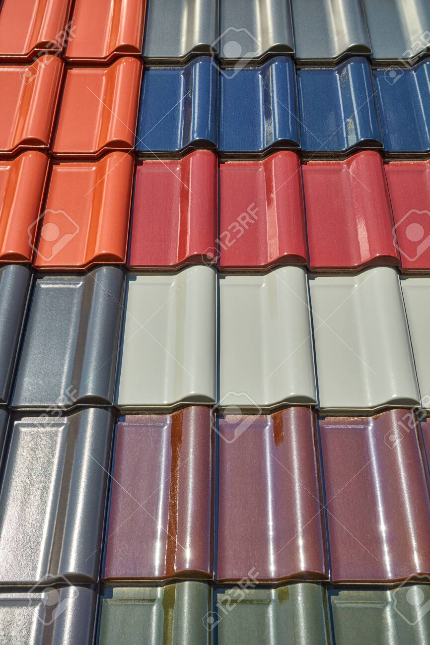 a roof is covered with different colored roof tiles