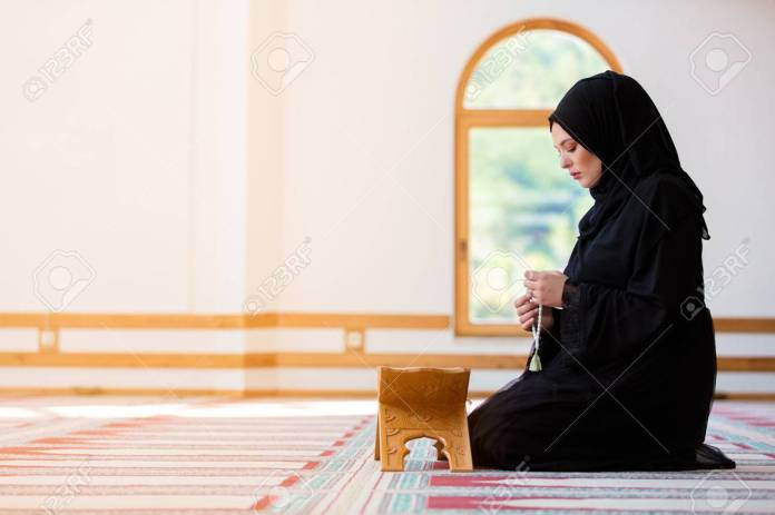 Young Muslim Woman Praying In Mosque Stock Photo, Picture And Royalty Free  Image. Image 87343031.
