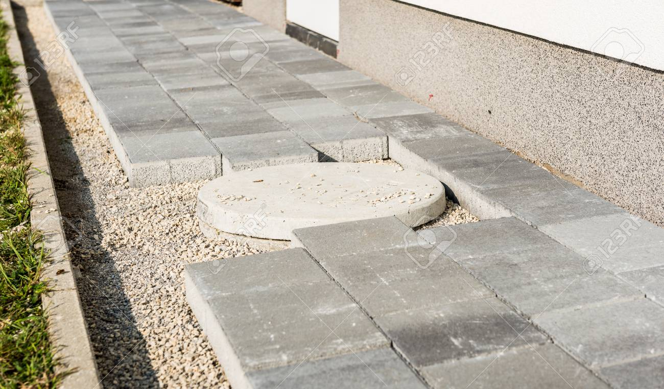 laying gray concrete paving slabs in house courtyard driveway stock photo picture and royalty free image image 108834248