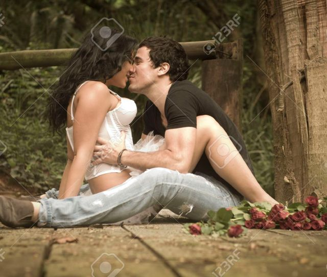 Stock Photo Young Beautiful Sexy Couple In Love Flirting Together On Wooden Deck