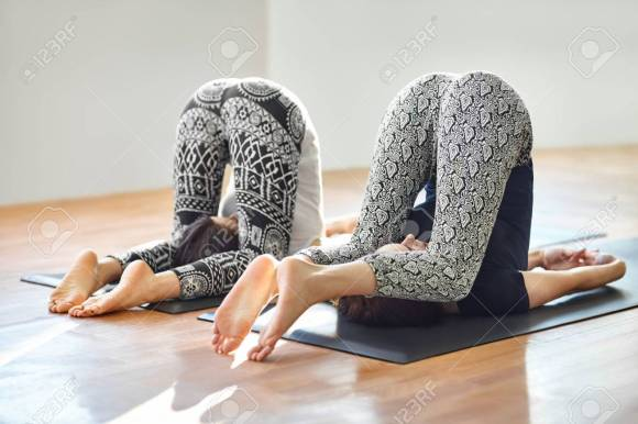 Two Young Women Doing Yoga Asana Easy Plow Pose. Purva Halasana Stock  Photo, Picture And Royalty Free Image. Image 60891631.