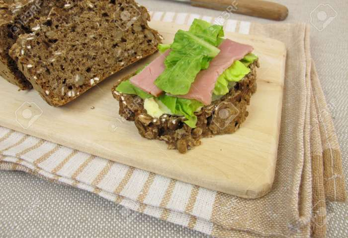 Black Bread Sandwich With Ham And Lettuce Leaf Stock Photo Picture