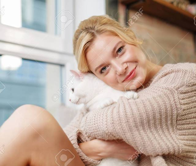 Portrait Of Kind Girl Showing Love To Her Kitty She Is Hugging