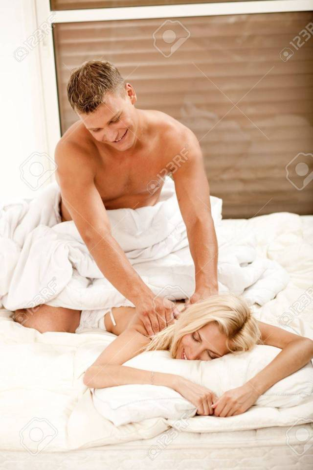 Smiling Young Lady Getting A Romantic Massage Stock Photo 5674057