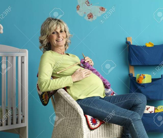 Pregnant Mature Woman Knitting Stock Photo