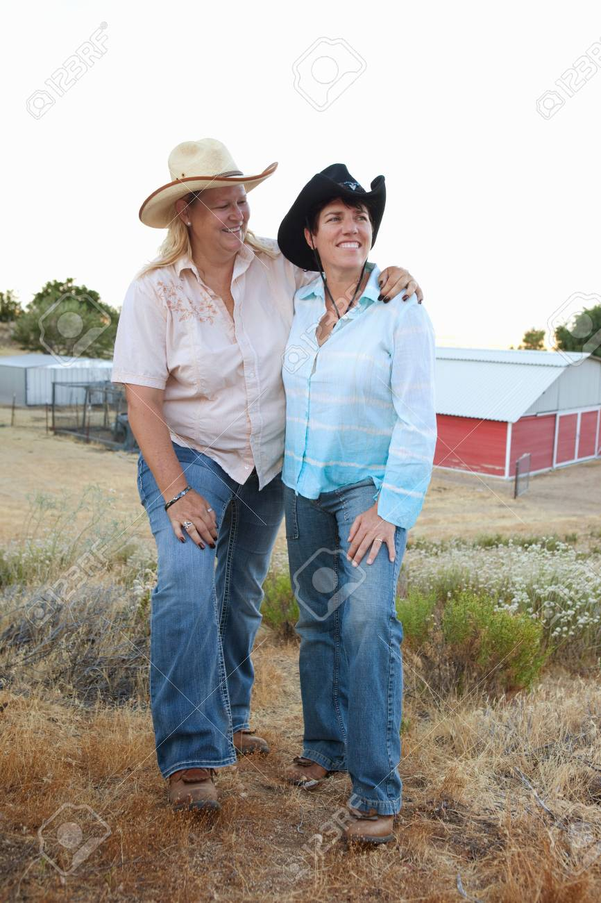 Mature Lesbian Couple Standing Together On Ranchsmiling Stock Photo 86290932