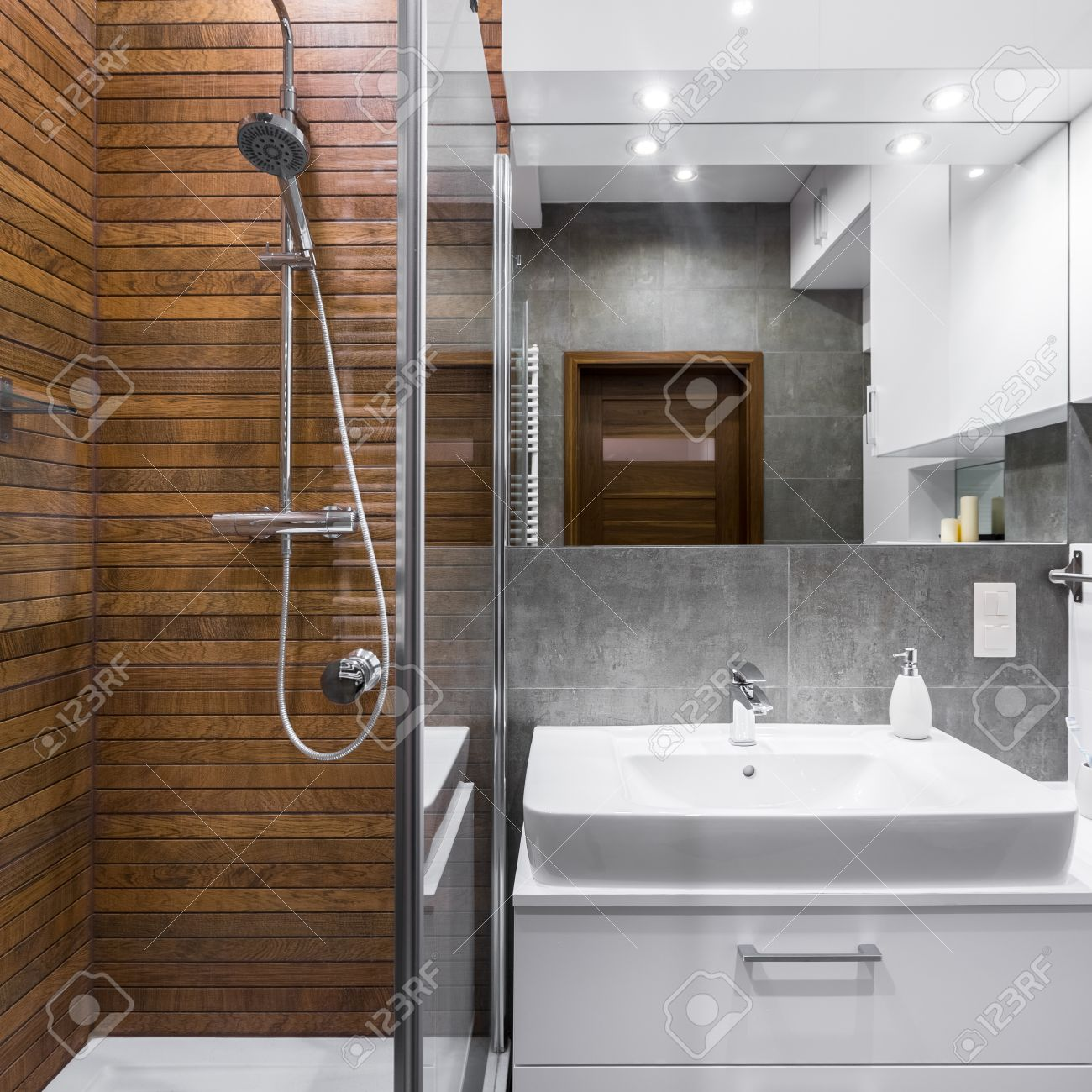 new style bathroom with wood effect tiles shower mirror and stock photo picture and royalty free image image 67105002