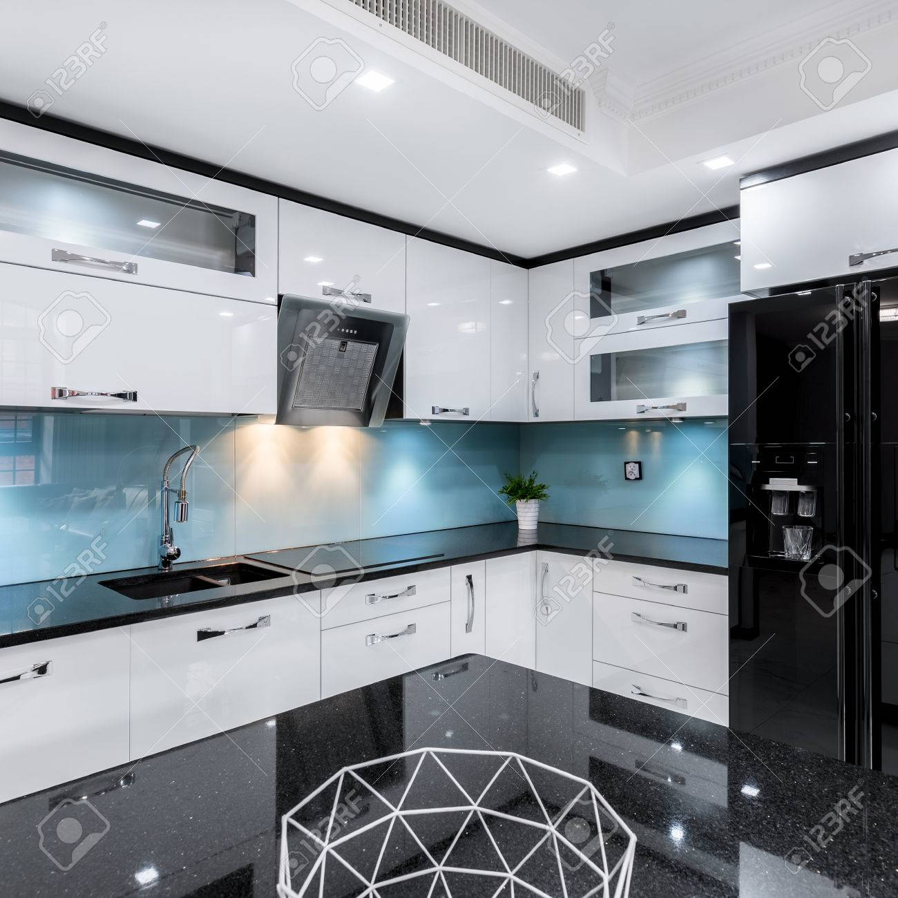 Modern Black And White High Gloss Kitchen With Table And Countertop
