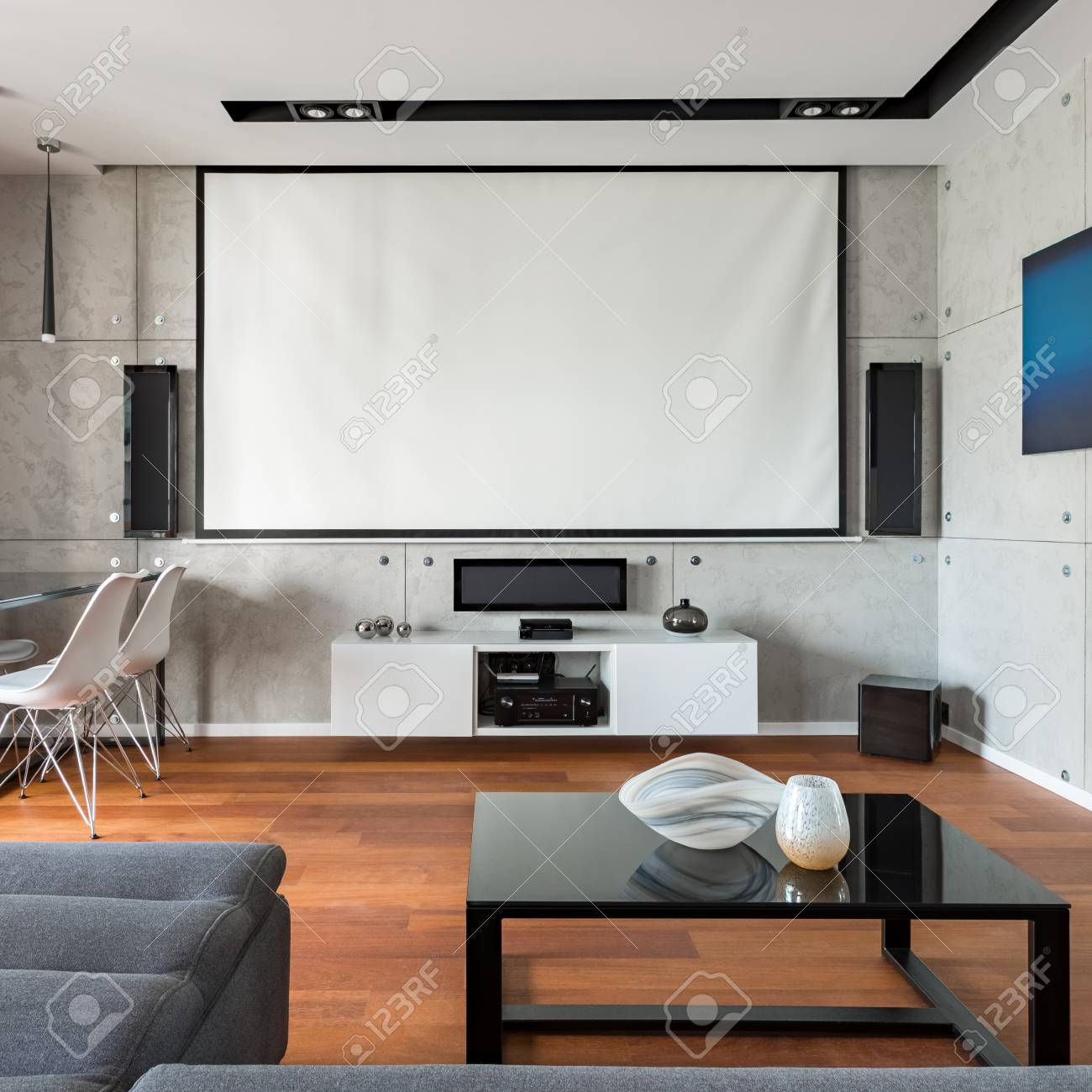 stylish home interior with big projector screen and modern coffee stock photo picture and royalty free image image 103113031