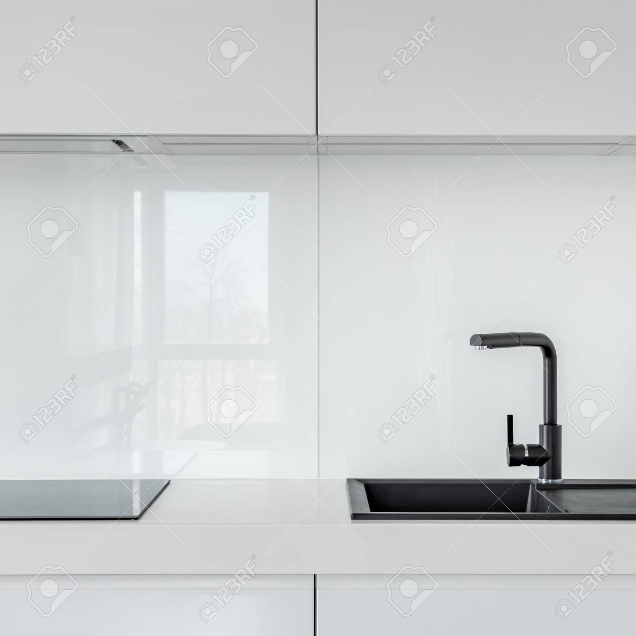 kitchen with white cabinets countertop and black composite kitchen stock photo picture and royalty free image image 107812393