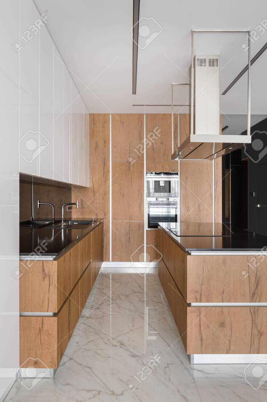 stylish kitchen with wooden furniture kitchen island and marble stock photo picture and royalty free image image 138455367