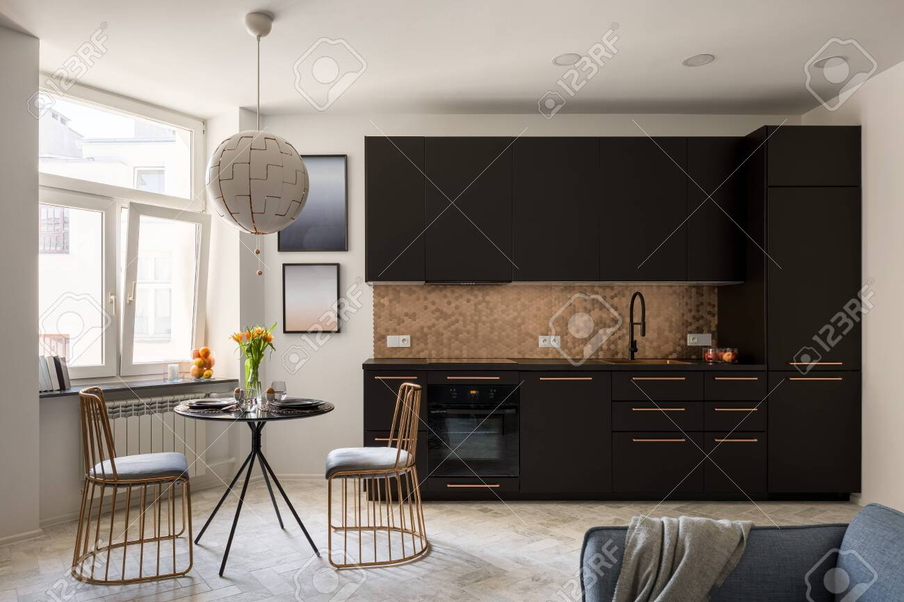 stylish kitchen with black furniture and copper hexagon tiles stock photo picture and royalty free image image 147768439