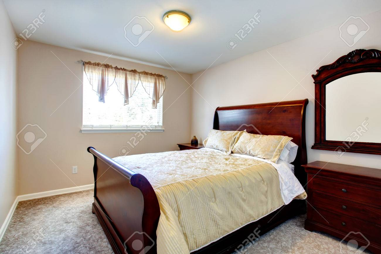Cozy Bedroom With Beige Carpet Floor Carved Wood Mirror Cherry