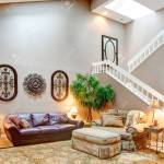 High Vaulted Ceiling Living Room Furnished With Leather Couch