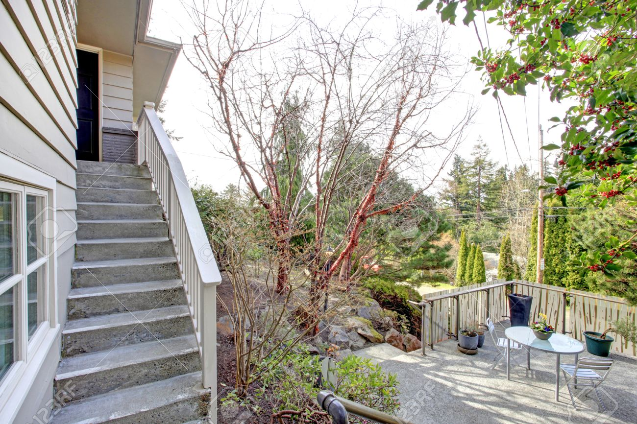 https www 123rf com photo 26451080 clapboard siding house on a hill view of the entrance door with stairs and roof top deck with patio html