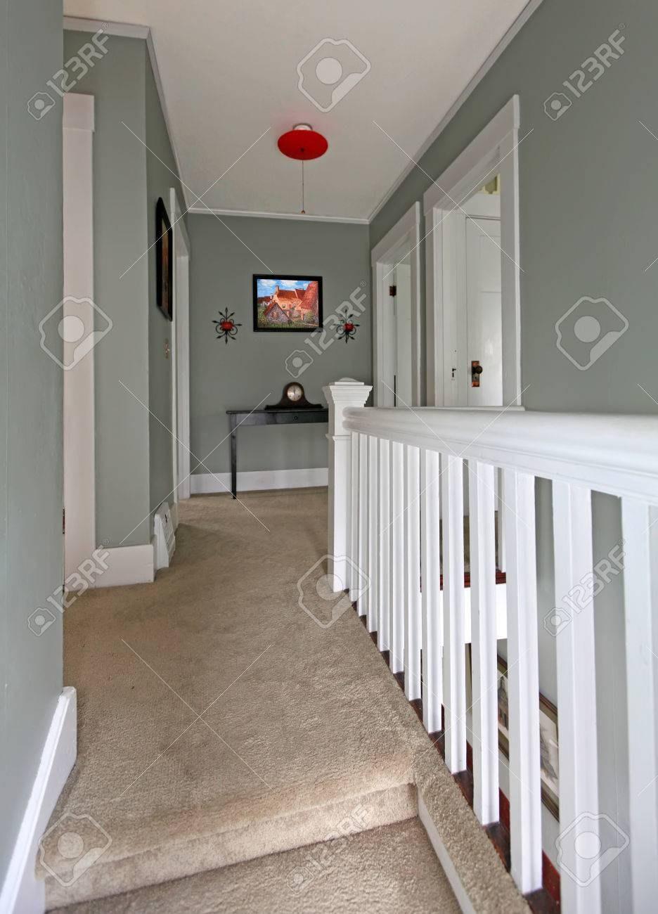 Grey Upstairs Hallway With White Railing And Beige Carpet Stock   Beige Carpet On Stairs   Pattern   Dark Beige   Nice   Bound Edge   Hardwood Transition