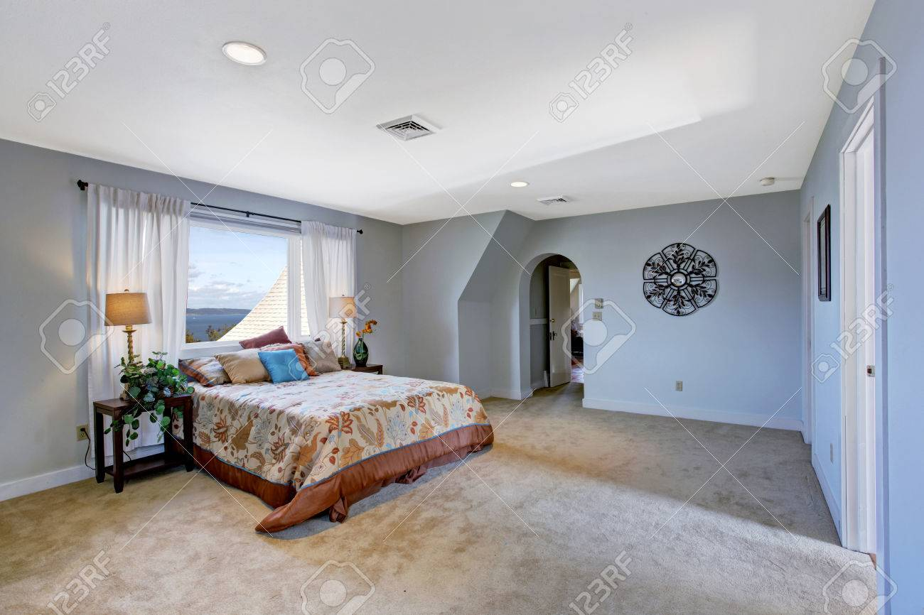 Spacious Bedroom In Light Blue Color With Soft Beige Carpet Floor Stock Photo Picture And Royalty Free Image Image 29938670