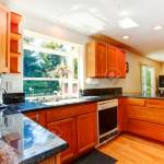 Kitchen Room With Wooden Cabinets And Black Granite Tops View Stock Photo Picture And Royalty Free Image Image 31088103