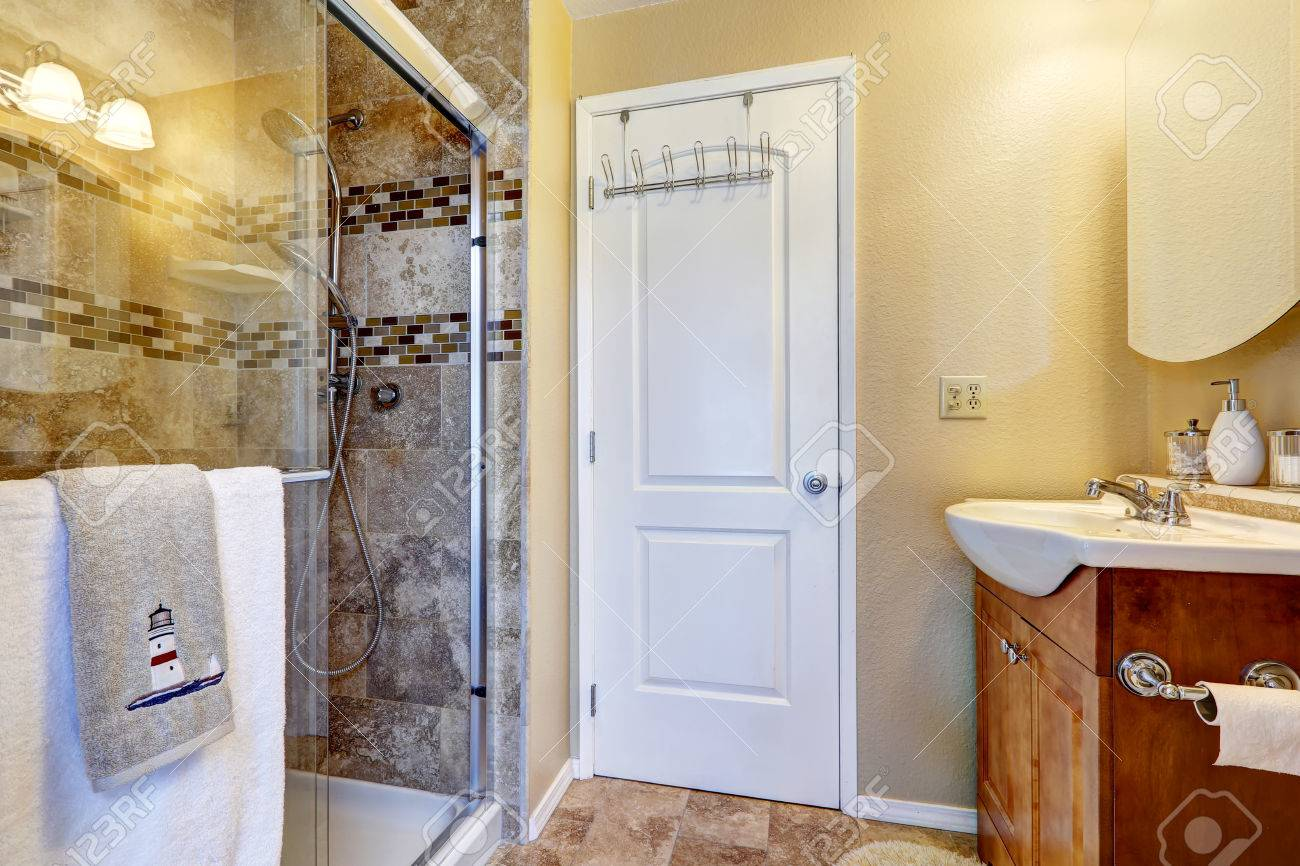 bathroom with tile wall trim and glass door shower stock photo picture and royalty free image image 31273646