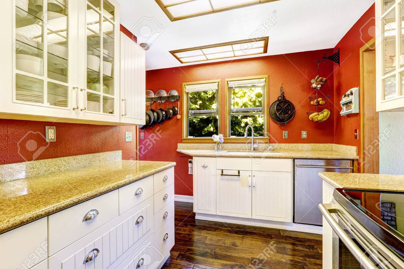 Kitchen Room With Bright Red Wall And White Cabinets With Granite Stock Photo Picture And Royalty Free Image Image 31306155