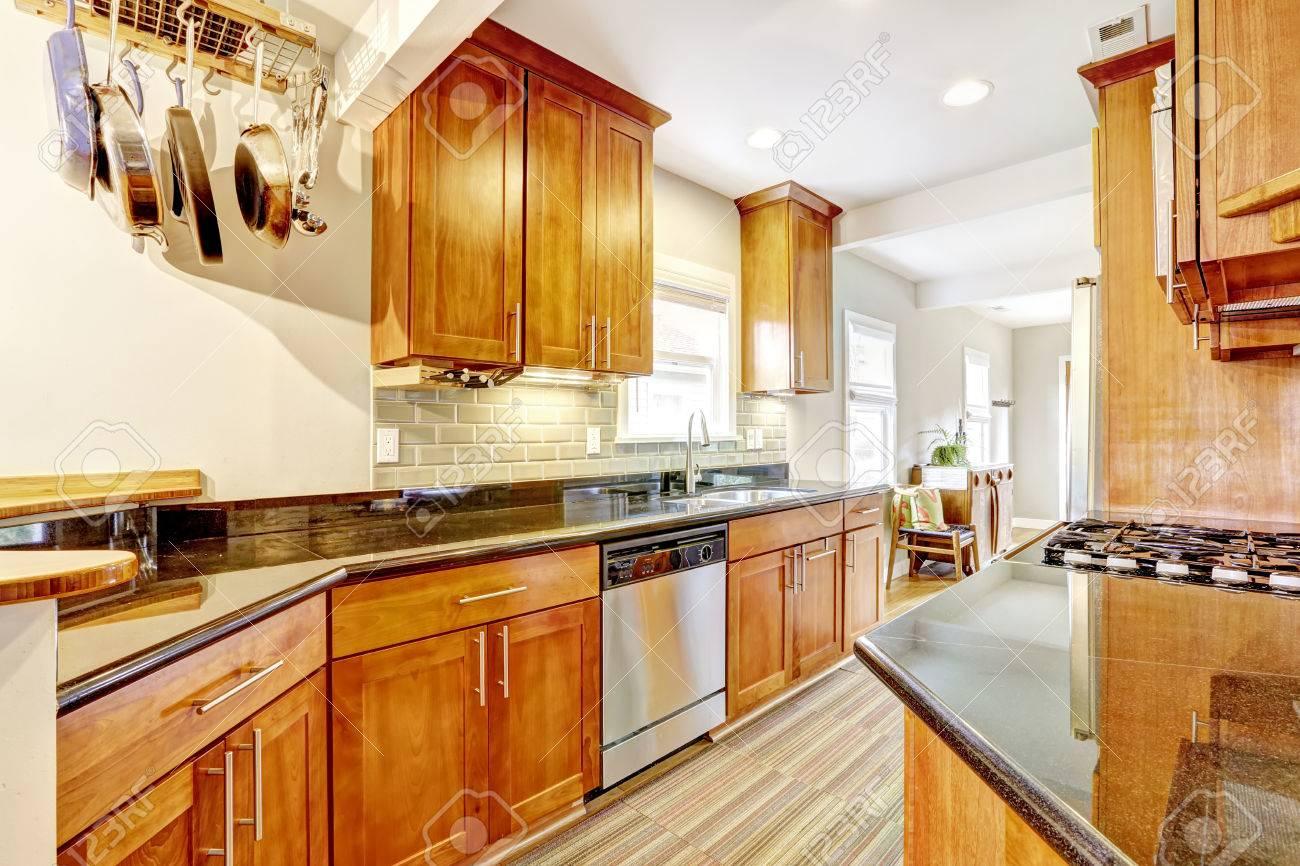Best Kitchen Gallery: Bright Brown Kitchen Cabi S With Black Granite Tops Kitchen of Tops Kitchen Cabinets on rachelxblog.com