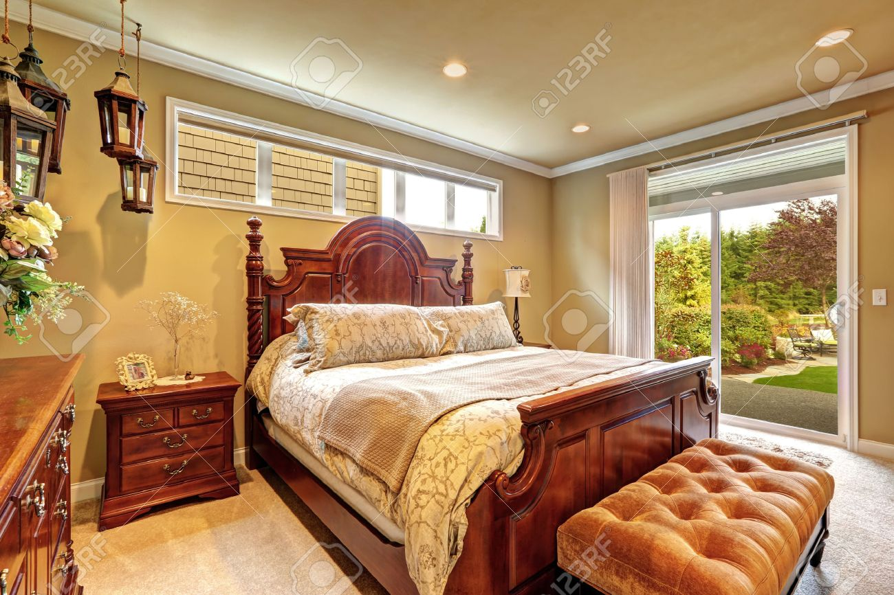 Luxury Bedroom With Carved Wood Bed Nightstand Ottoman And