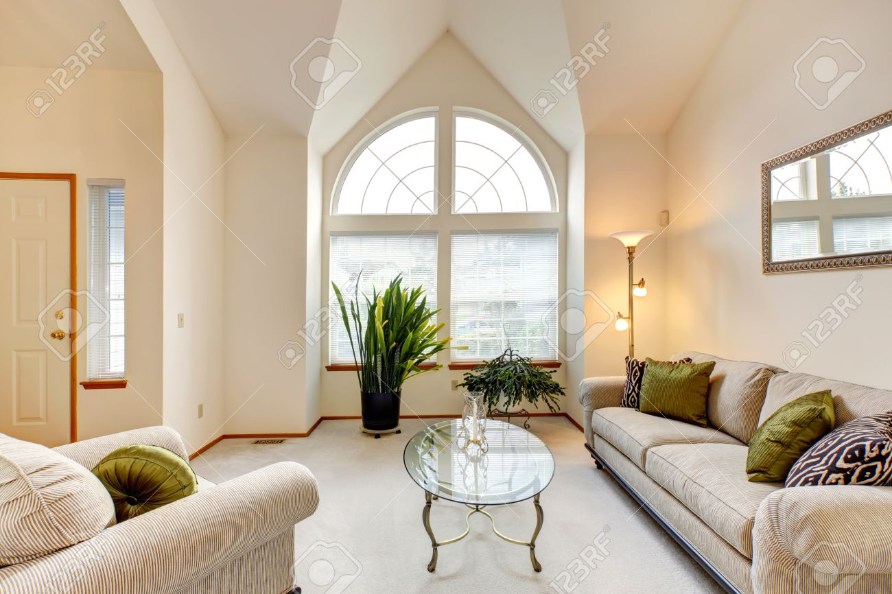 https www 123rf com photo 32708350 luxury family room in soft creamy tones with hight ceiling and arch window room with sofa and armcha html