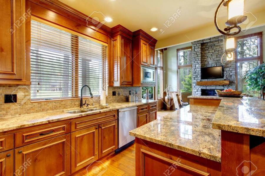 Brilliant Kitchen With Stained Wood Cabinets  And Glossy Counter     Brilliant kitchen with stained wood cabinets  and glossy counter tops   Stock Photo   54327389