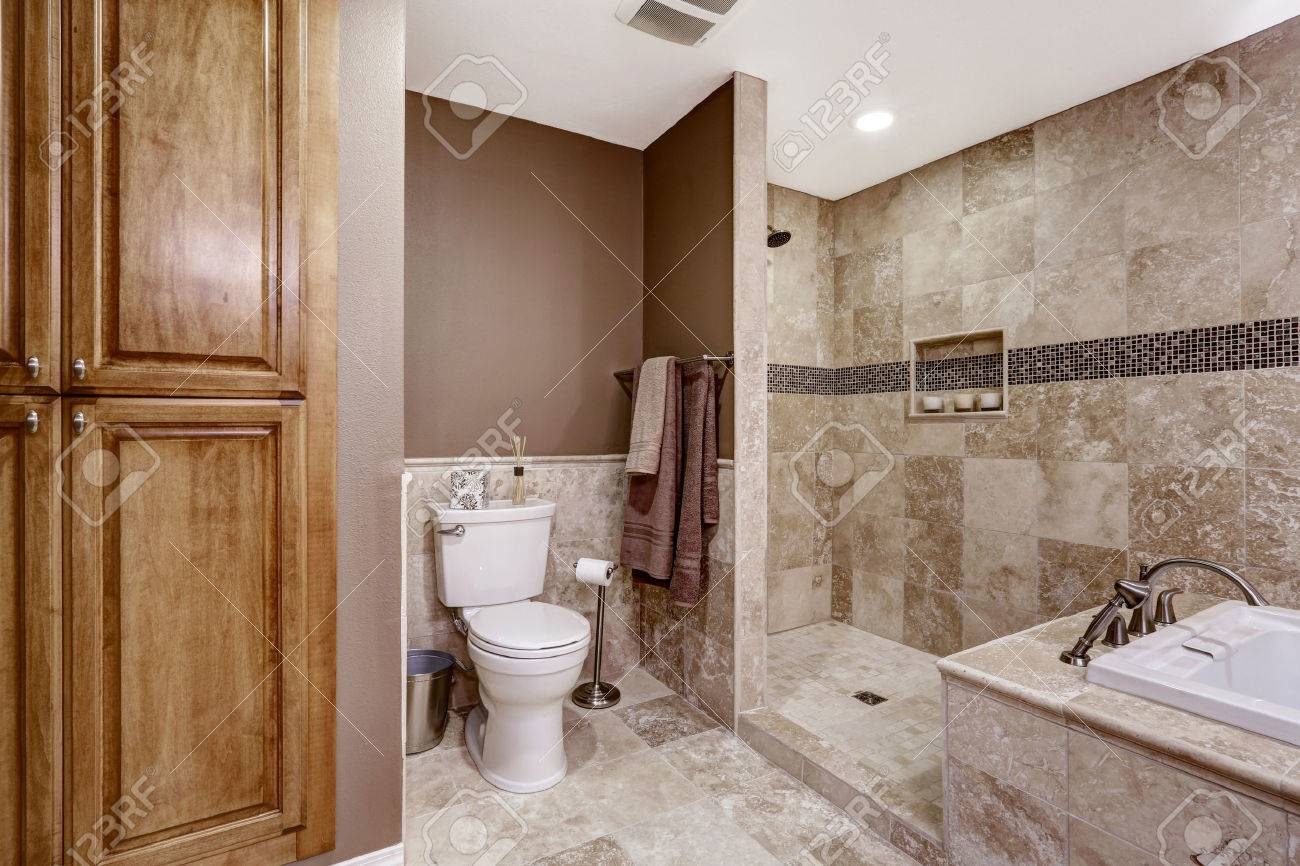 empty bathroom interior light brown tile bath tub shower and