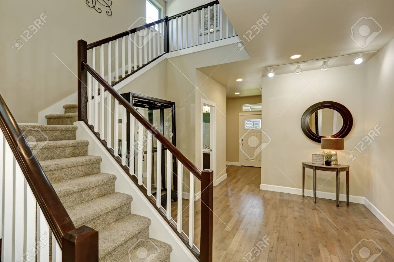 Light Beige Hallway Interior Carpeted Staircase Hardwood Floor | Hardwood Floors With Carpeted Stairs | Wall To Wall Carpet | Painting | Laminate Hall Carpet | Carpet Covered | Carpet Wrapped
