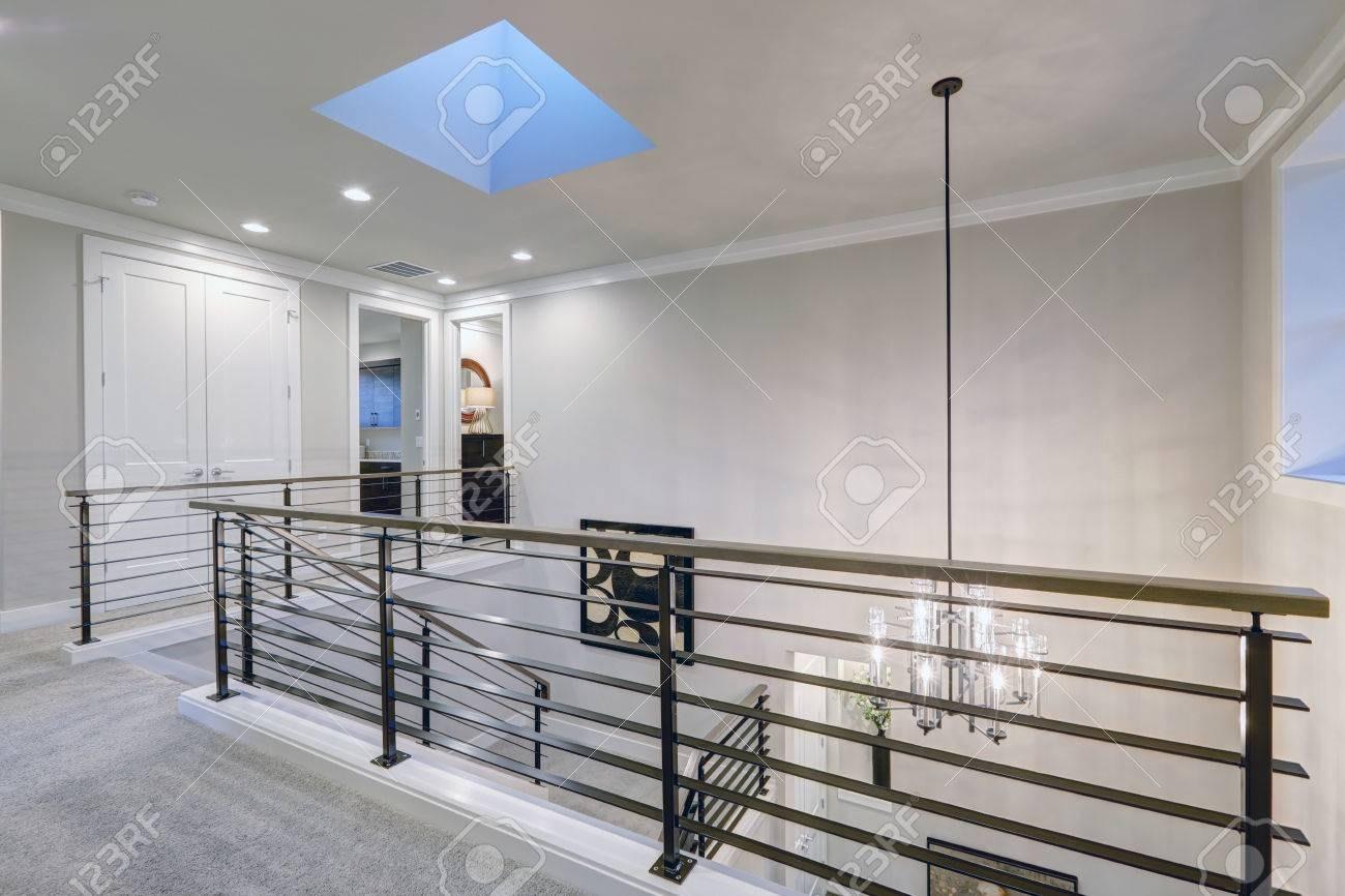 Second Floor Landing In Gray Tones Features Skylight Over The   Metal Horizontal Stair Railing   Art Deco   Modern Style   Brushed Nickel   Split Level Foyer   Deck
