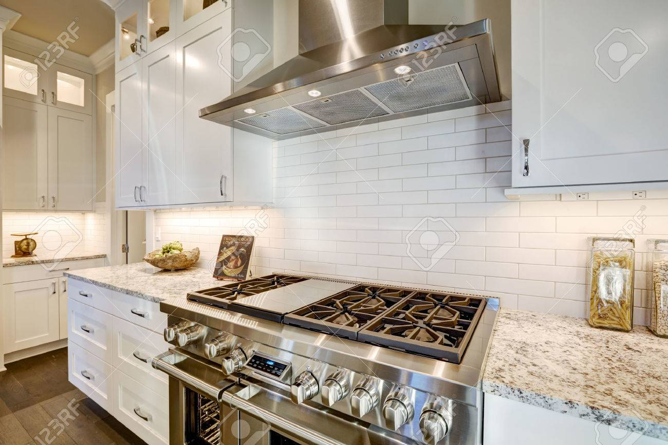 beautiful kitchen features a nook filled with stainless steel