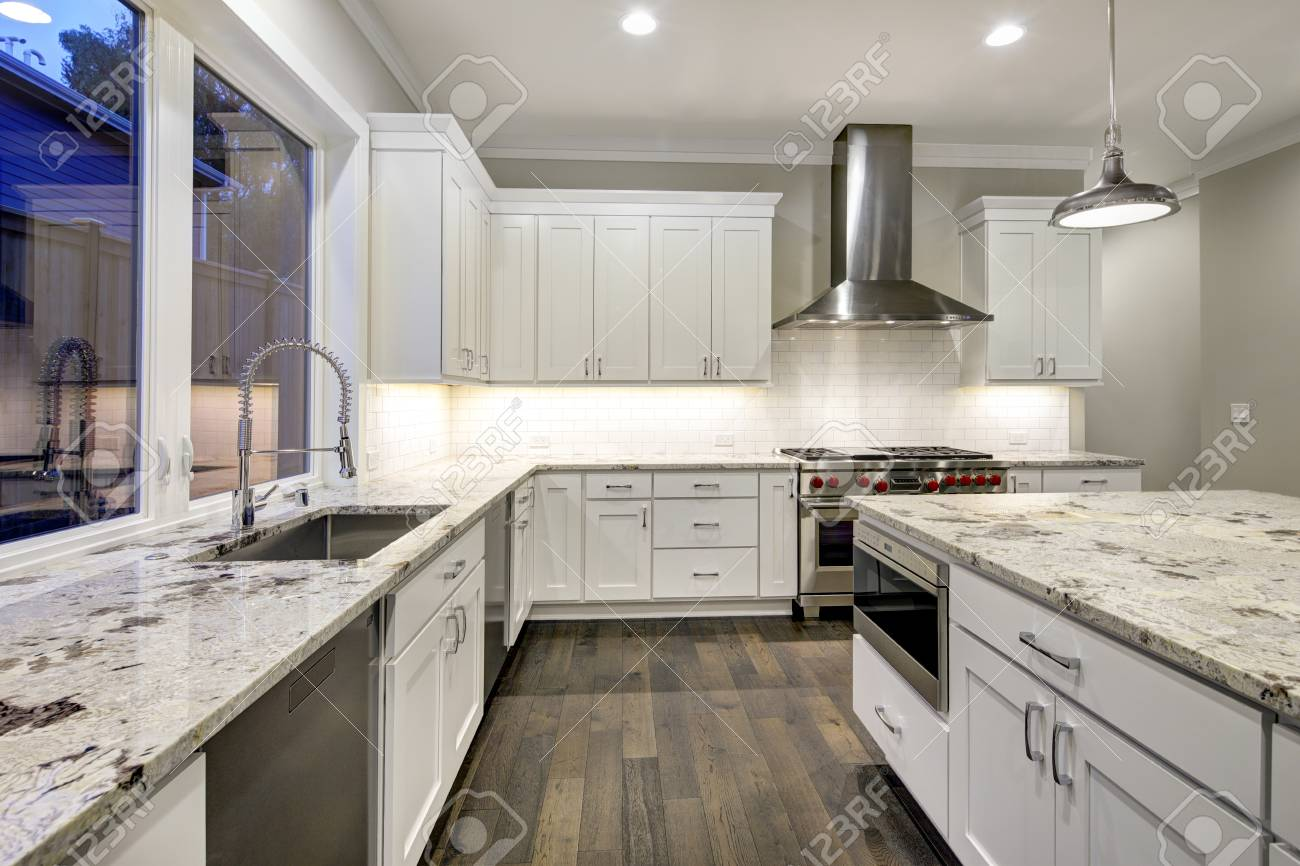 Large Spacious Kitchen Design With White Kitchen Cabinets White Stock Photo Picture And Royalty Free Image Image 90031157