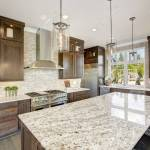 Luxury Kitchen Accented With Large Granite Kitchen Island Taupe Stock Photo Picture And Royalty Free Image Image 90183130