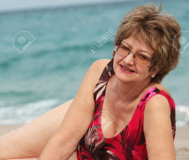Mature Woman Relaxing At The Beach Stock Photo 4283009