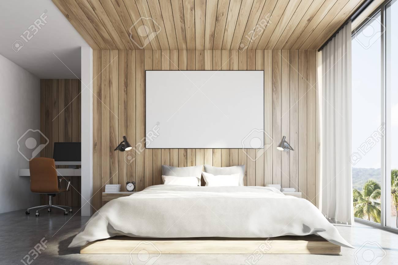 vue de face d un interieur de chambre a coucher en bois clair avec un lit double une table de chevet une affiche horizontale et une grande fenetre