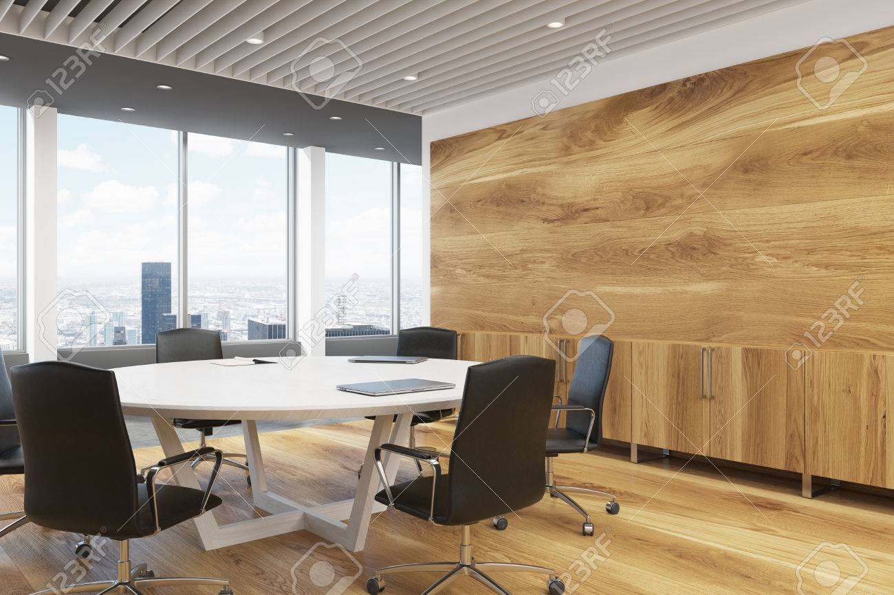 Corner Of A Dark Wooden Wall Decoration And A Large Round Meeting     Corner of a dark wooden wall decoration and a large round meeting room  table  3d